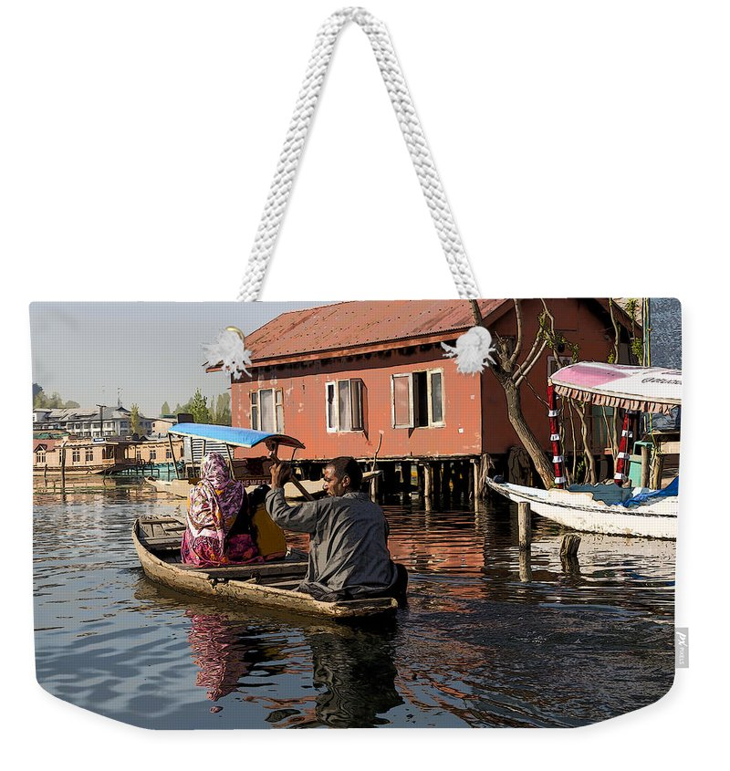 Action Weekender Tote Bag featuring the digital art Cartoon - Man Rowing A Family In A Wooden Boat by Ashish Agarwal