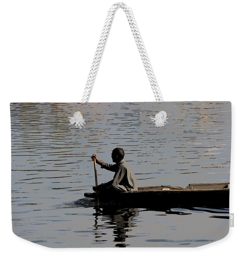 Beautiful Scene Weekender Tote Bag featuring the digital art Cartoon - Splashing In The Water Caused Due To Kashmiri Man Rowing A Small Boat by Ashish Agarwal