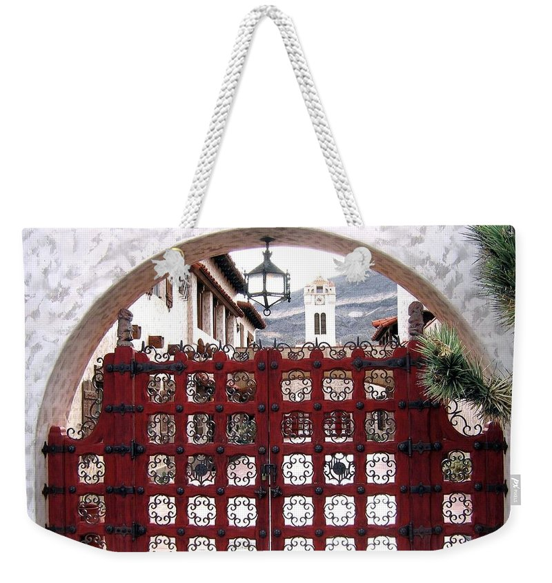 Castle Gate Weekender Tote Bag featuring the photograph Castle Gate by Will Borden
