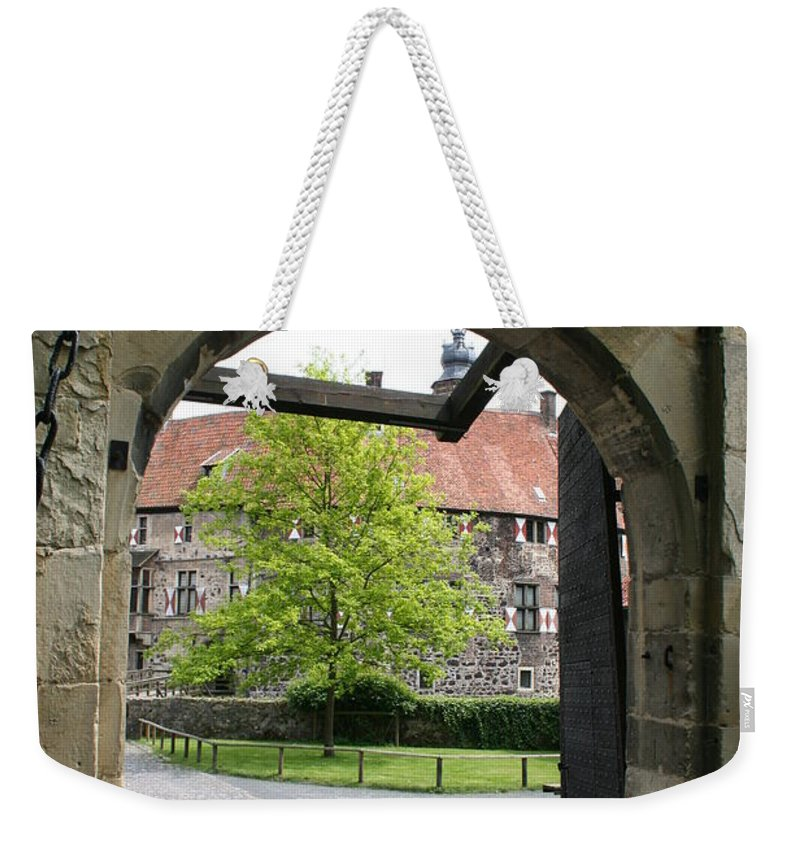 Entrance Weekender Tote Bag featuring the photograph Castle Vischering Archway by Christiane Schulze Art And Photography