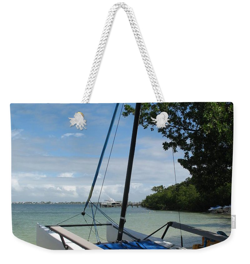 Beach Weekender Tote Bag featuring the photograph Catamaran On The Beach by Christiane Schulze Art And Photography