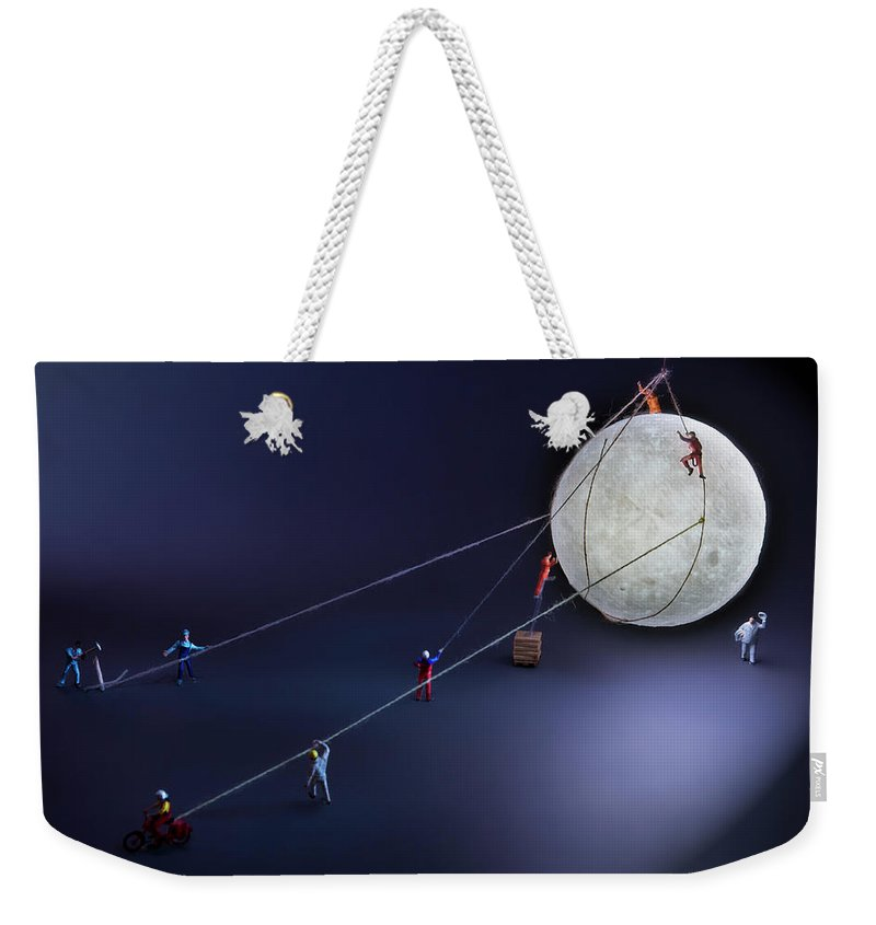 Planetary Moon Weekender Tote Bag featuring the photograph Catch The Moon by Antonio Iacobelli
