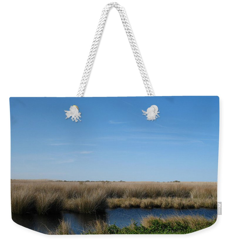 The Causeway Weekender Tote Bag featuring the photograph Causeway by Shannon Louder