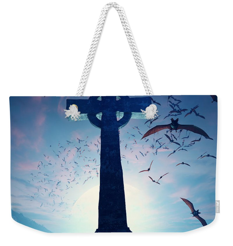 Cross Weekender Tote Bag featuring the photograph Celtic Cross With Swarm Of Bats by Johan Swanepoel
