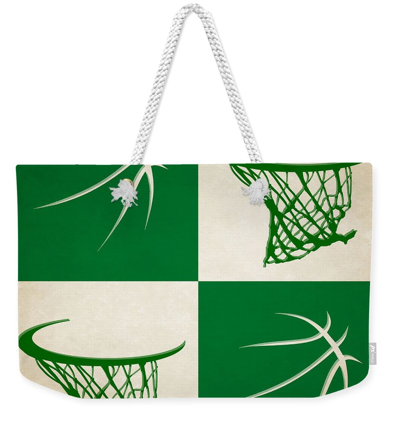 Celtics Weekender Tote Bag featuring the photograph Celtics Ball And Hoop by Joe Hamilton