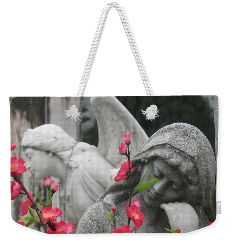 Cemetery Weekender Tote Bag featuring the photograph Cemetery Stone Angels And Flowers by Ian Mcadie