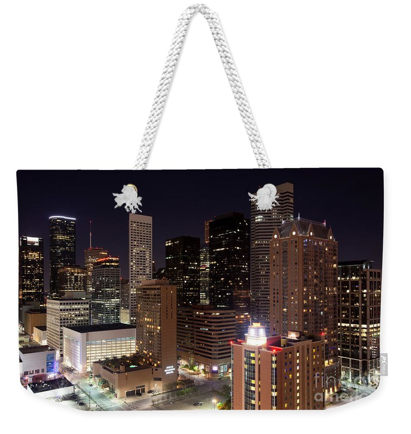 Houston Weekender Tote Bag featuring the photograph Central Houston At Night by Bill Cobb