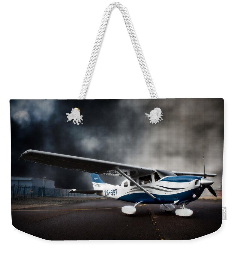 Cessna Weekender Tote Bag featuring the photograph Cessna Ground by Paul Job