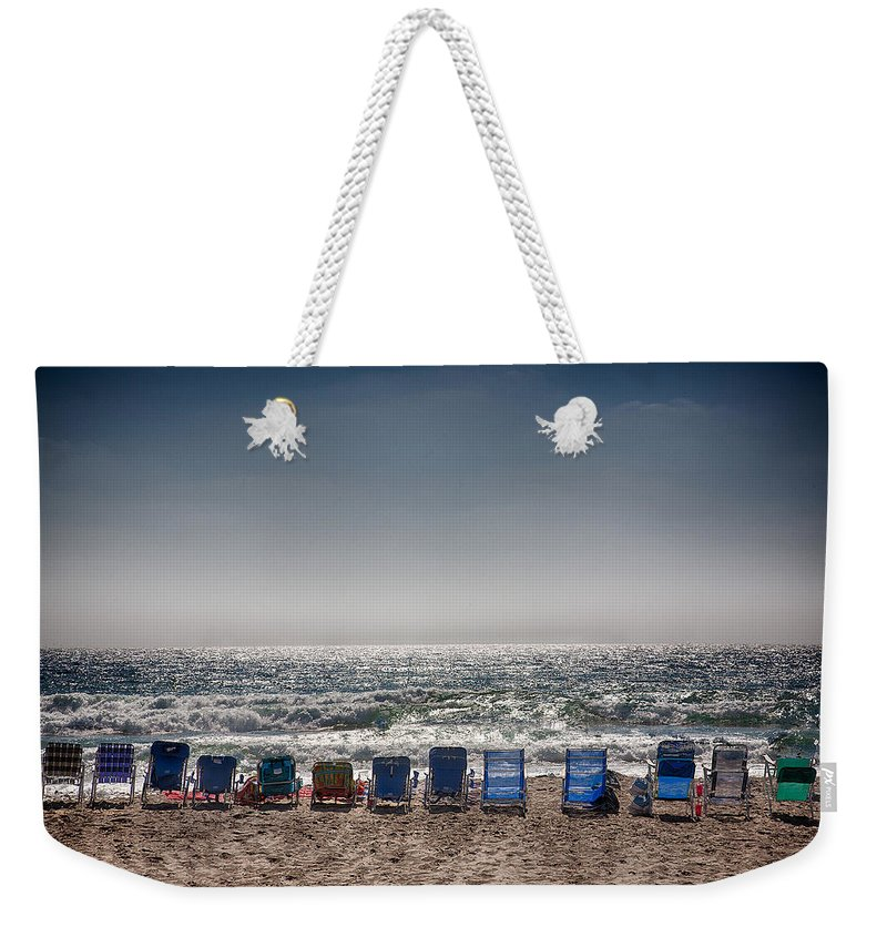 Beach Weekender Tote Bag featuring the photograph Chairs Watching The Sunset by Peter Tellone