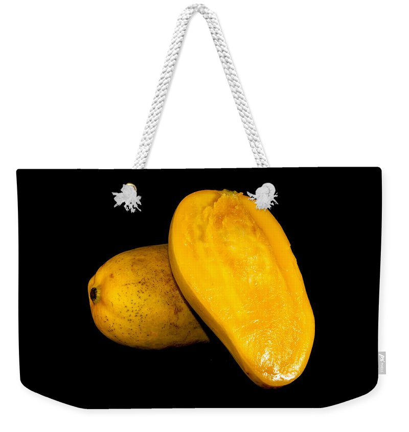 Ataulfo Weekender Tote Bag featuring the photograph Champagne Ataulfo Mango Closeup Isolated by Alex Grichenko