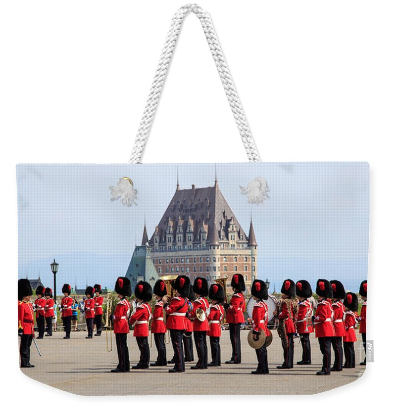 Quebec Weekender Tote Bag featuring the photograph Changing Of The Guard The Citadel Quebec City by Edward Fielding