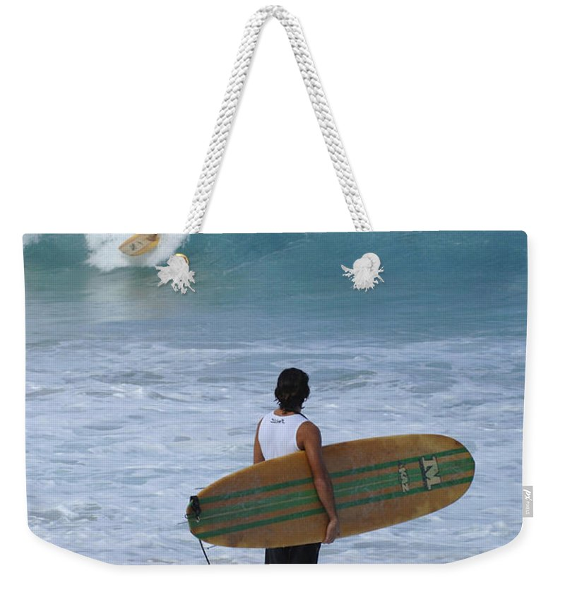 Extreme Sports Weekender Tote Bag featuring the photograph Surfing Hawaii Checking It Out by Bob Christopher