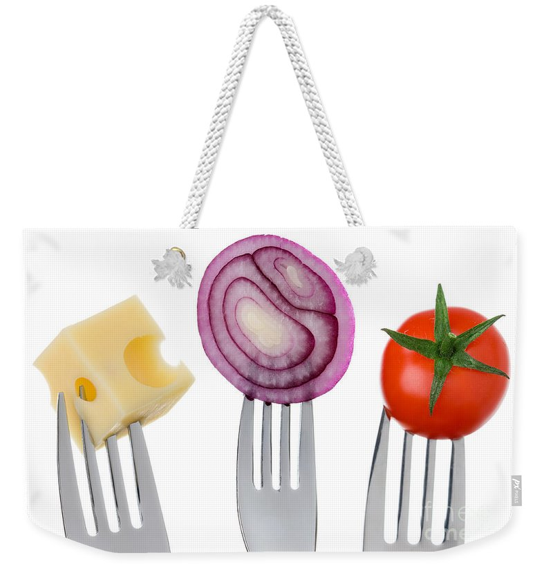 Cheese Weekender Tote Bag featuring the photograph Cheese Onion And Tomato On Forks Against White by Lee Avison