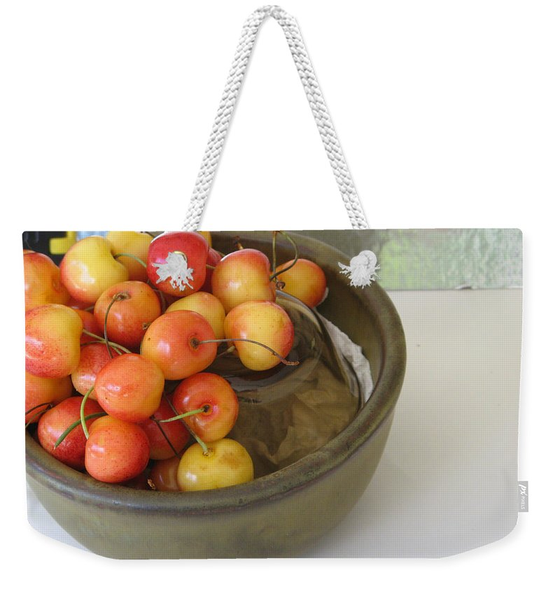Cherries Weekender Tote Bag featuring the photograph Cherries And Glass Filler by Rich Franco
