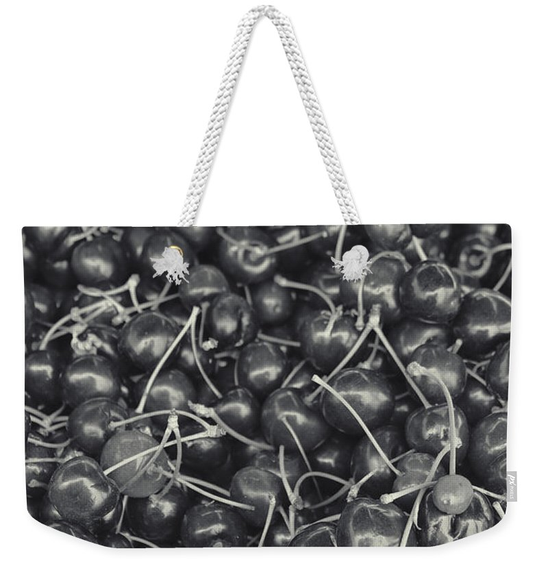 Cherries Weekender Tote Bag featuring the photograph Cherries Black And White by Cathy Anderson