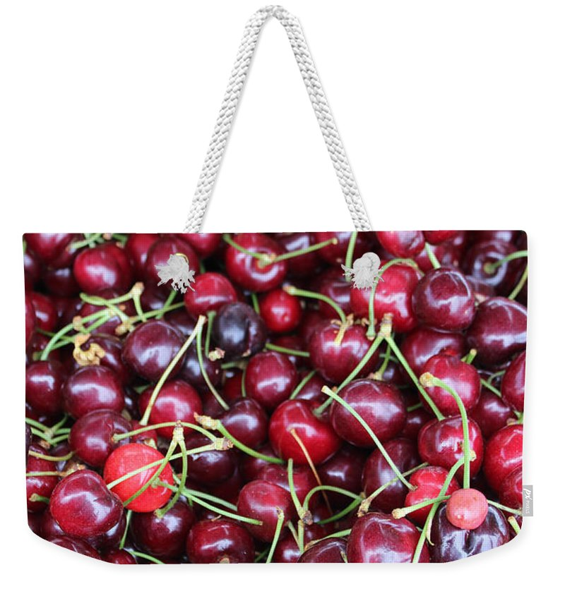 Cherries Weekender Tote Bag featuring the photograph Cherries In Des Moines Washington by Cathy Anderson