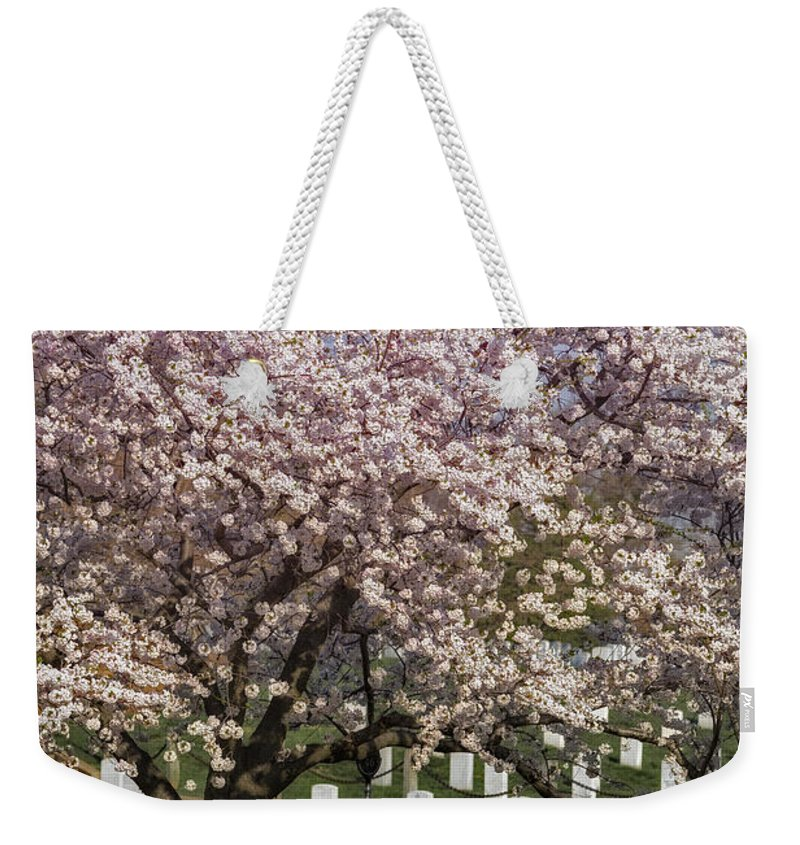 America Weekender Tote Bag featuring the photograph Cherry Blossoms Grace Arlington National Cemetery by Susan Candelario