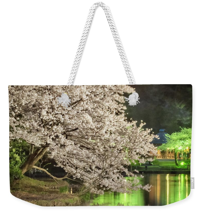 Temple Buddhism Asian Meditation Buddhist Religious Religion Culture Asia Buddha Travel Oriental Worship Old Art Gold Siam Prayer Pray Faith Statue Traditional Tradition Chinese Ancient Sculpture Spiritual Zen China Meditate Weekender Tote Bag featuring the photograph Cherry Blossom Temple Boat by John Swartz