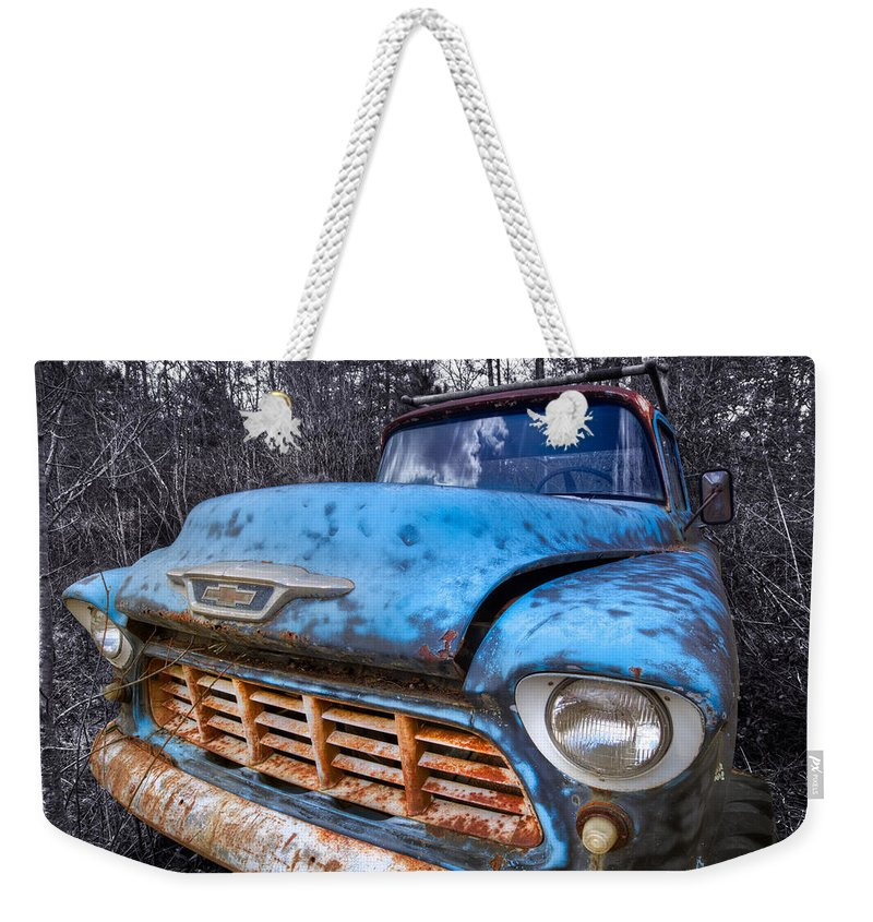 Appalachia Weekender Tote Bag featuring the photograph Chevy In The Woods by Debra and Dave Vanderlaan