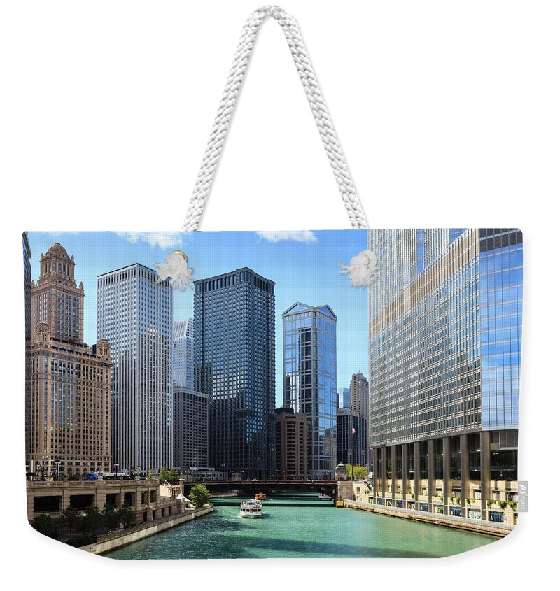Chicago River Weekender Tote Bag featuring the photograph Chicago River And Cityscape by Fraser Hall