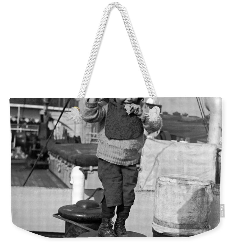 1926 Weekender Tote Bag featuring the photograph Child Arriving At Ellis Island by Underwood Archives
