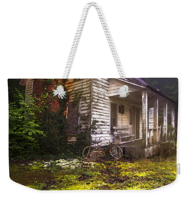 In Weekender Tote Bag featuring the photograph Childhood Dreams by Debra and Dave Vanderlaan