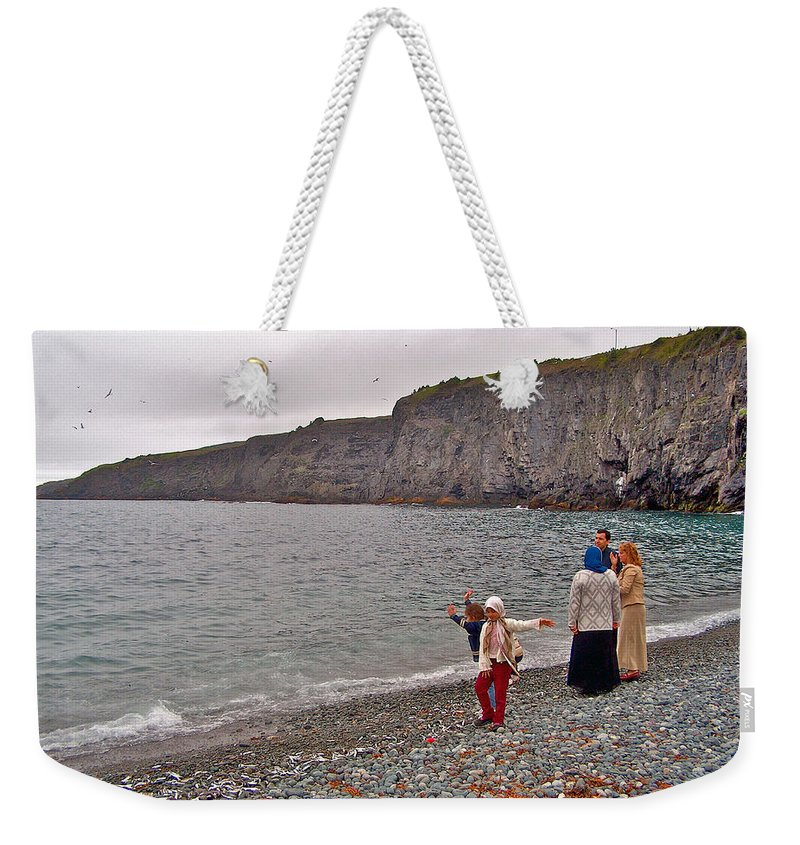 Children Throwing Capelin Back Into The Ocean At Middle Cove Weekender Tote Bag featuring the photograph Children Throwing Capelin Back Into The Ocean At Middle Cove-nl by Ruth Hager