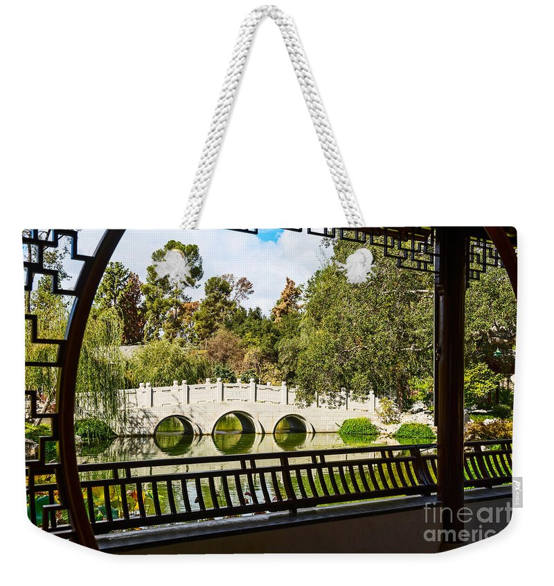 Chinese Garden Weekender Tote Bag featuring the photograph Chinese Garden Window by Jamie Pham