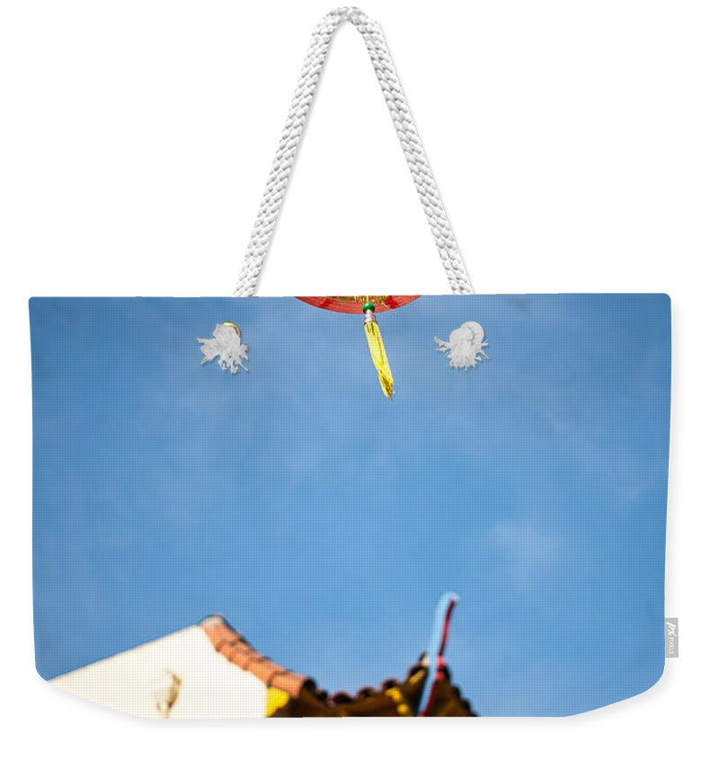 Buildings Weekender Tote Bag featuring the photograph Chinese Lantern by Peter Tellone