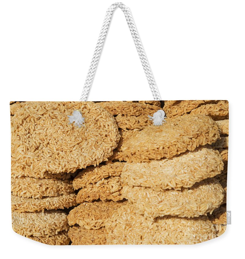 Asia Weekender Tote Bag featuring the photograph Chinese Rice Cakes by Jacek Malipan