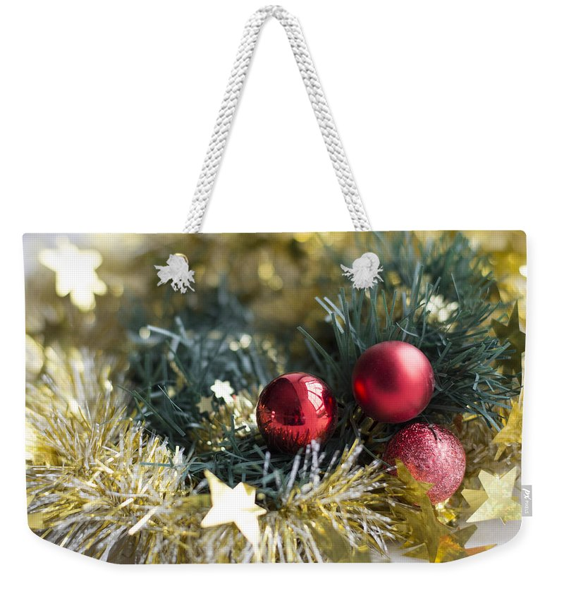 Christmas Weekender Tote Bag featuring the photograph Christmas Baubles by Jocelyn Friis