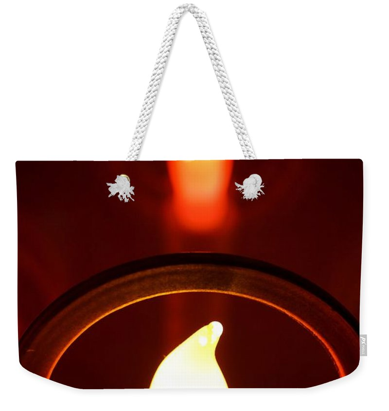 Abstract Weekender Tote Bag featuring the photograph Christmas Candle Reflection by Kerri Mortenson