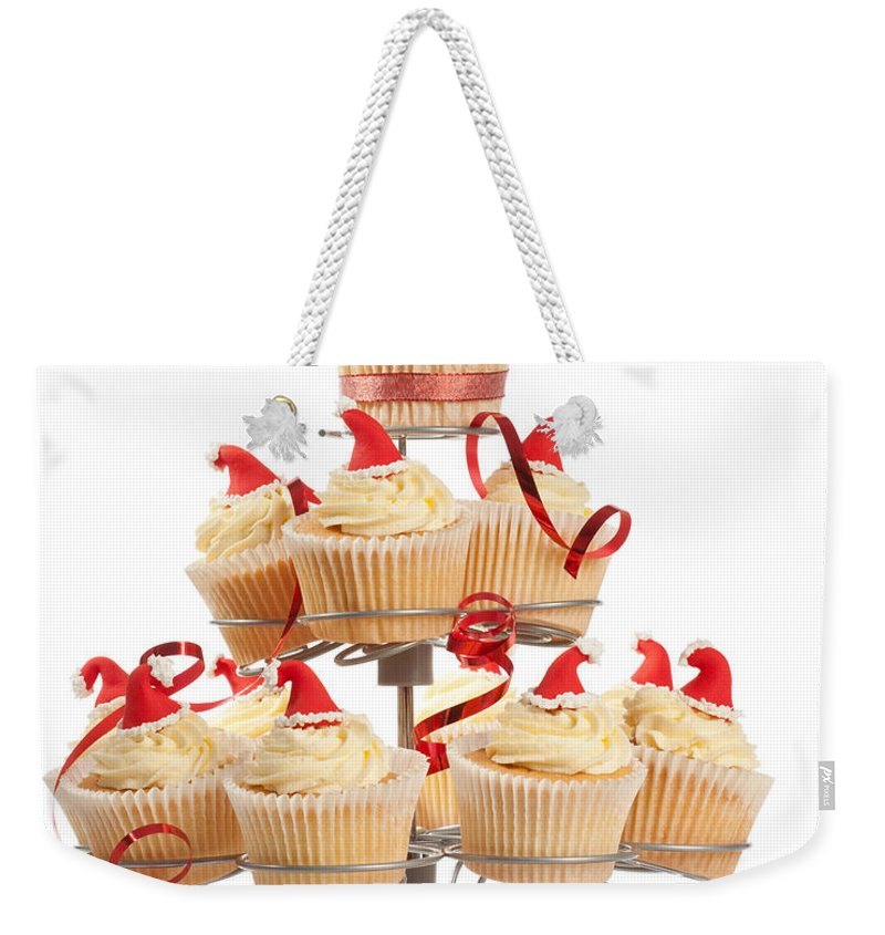 Christmas Weekender Tote Bag featuring the photograph Christmas Cupcakes On Stand by Amanda Elwell