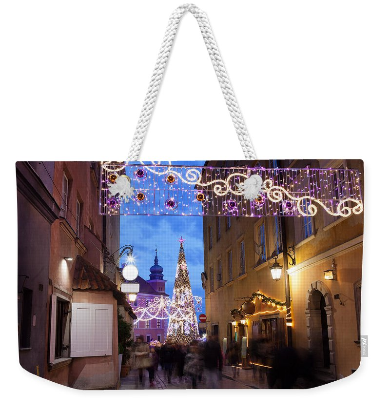 Warsaw Weekender Tote Bag featuring the photograph Christmas Illumination On Piwna Street In Warsaw by Artur Bogacki