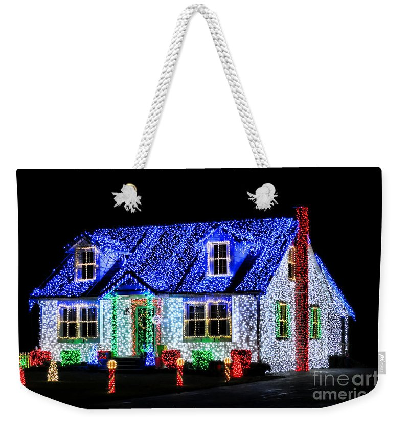 Christmas Weekender Tote Bag featuring the photograph Christmas Lighthouse by Olivier Le Queinec
