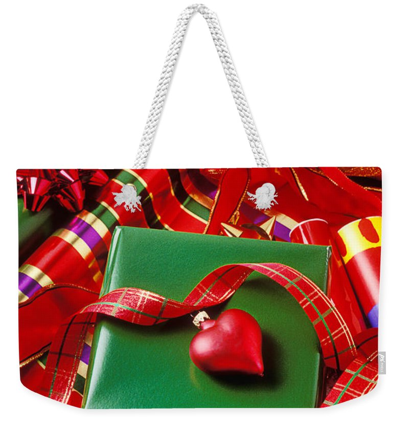 Christmas Weekender Tote Bag featuring the photograph Christmas Wrap With Heart Ornament by Garry Gay