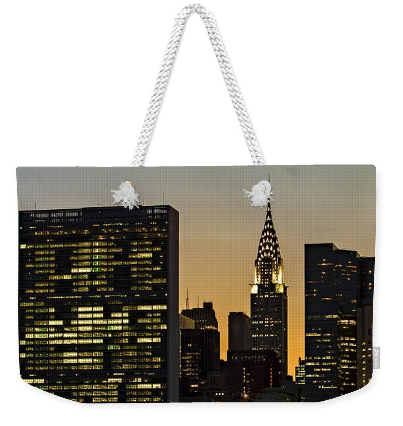 Chrylser Building Weekender Tote Bag featuring the photograph Chrysler And Un Buildings Sunset by Susan Candelario
