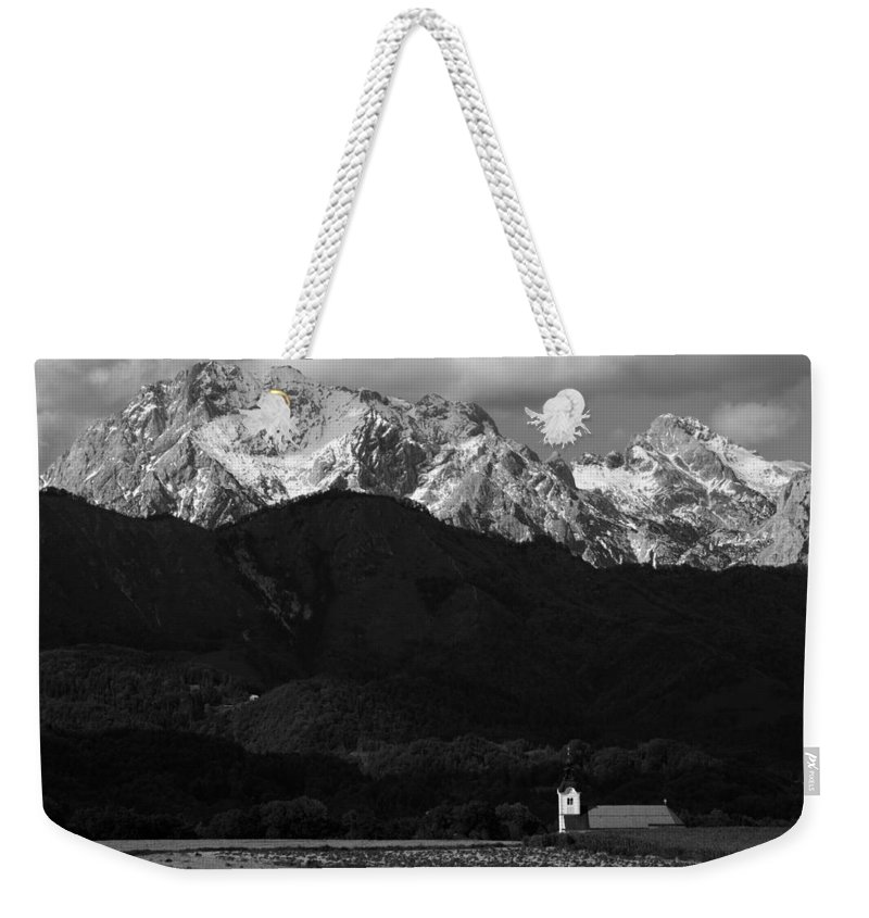Komenda Weekender Tote Bag featuring the photograph Church Of Saint Peter In Black And White by Ian Middleton
