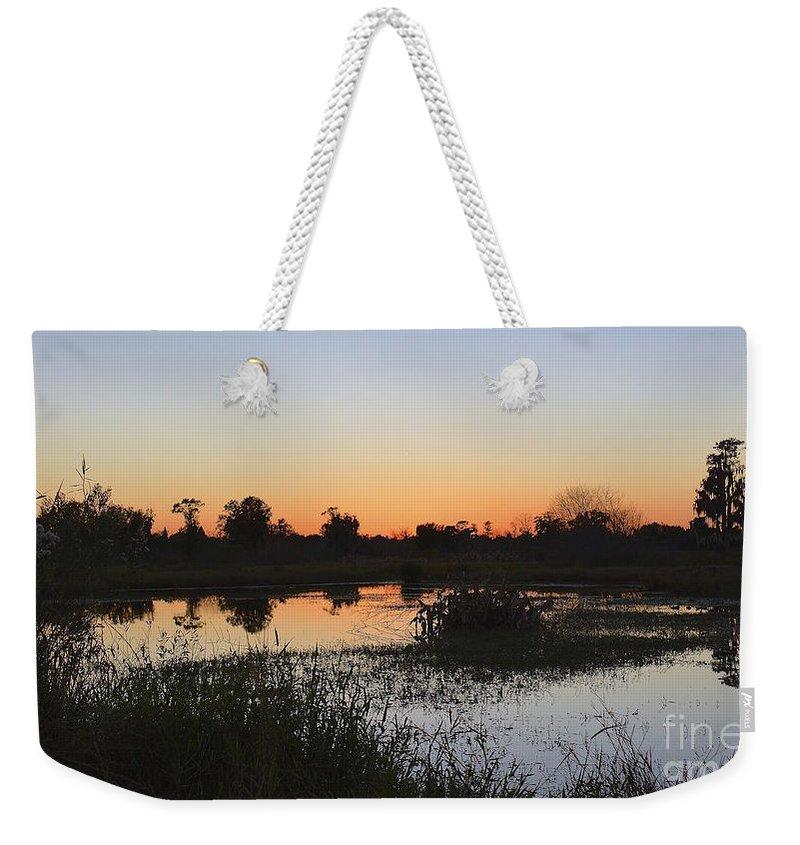 Circle B Weekender Tote Bag featuring the photograph Circle B Winter Sunset by Carol Bradley