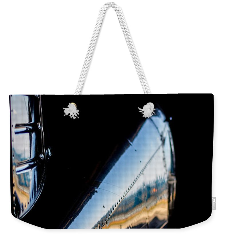 Cirrus Sr22 Weekender Tote Bag featuring the photograph Cirrus In A Hanger by Paul Job
