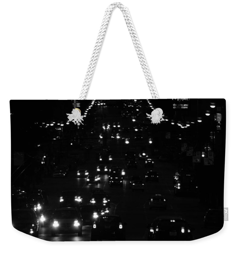 Night Weekender Tote Bag featuring the photograph City Nights by The Artist Project