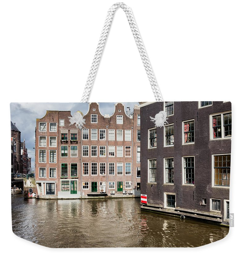 Amsterdam Weekender Tote Bag featuring the photograph City Of Amsterdam Canal Houses by Artur Bogacki