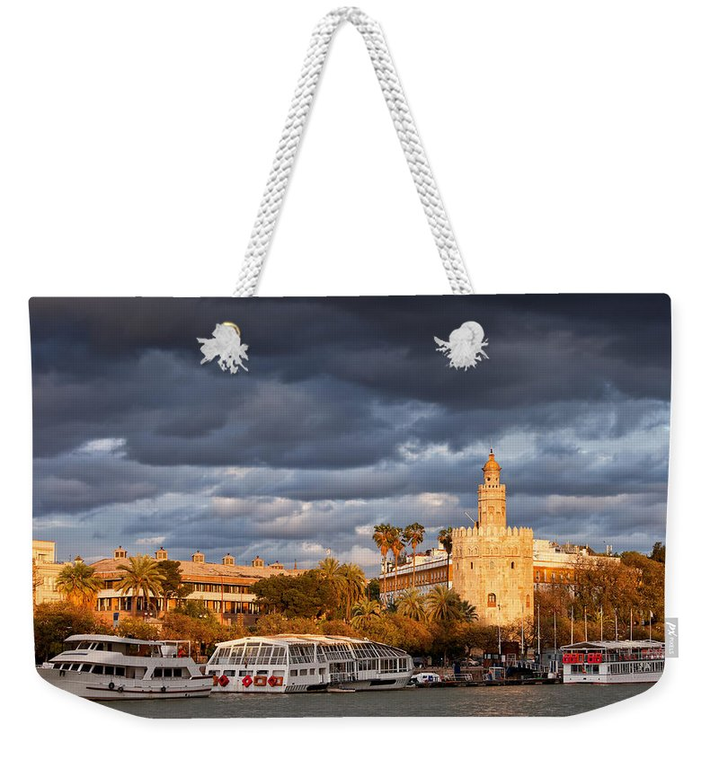 Guadalquivir Weekender Tote Bag featuring the photograph City Of Seville At Sunset by Artur Bogacki