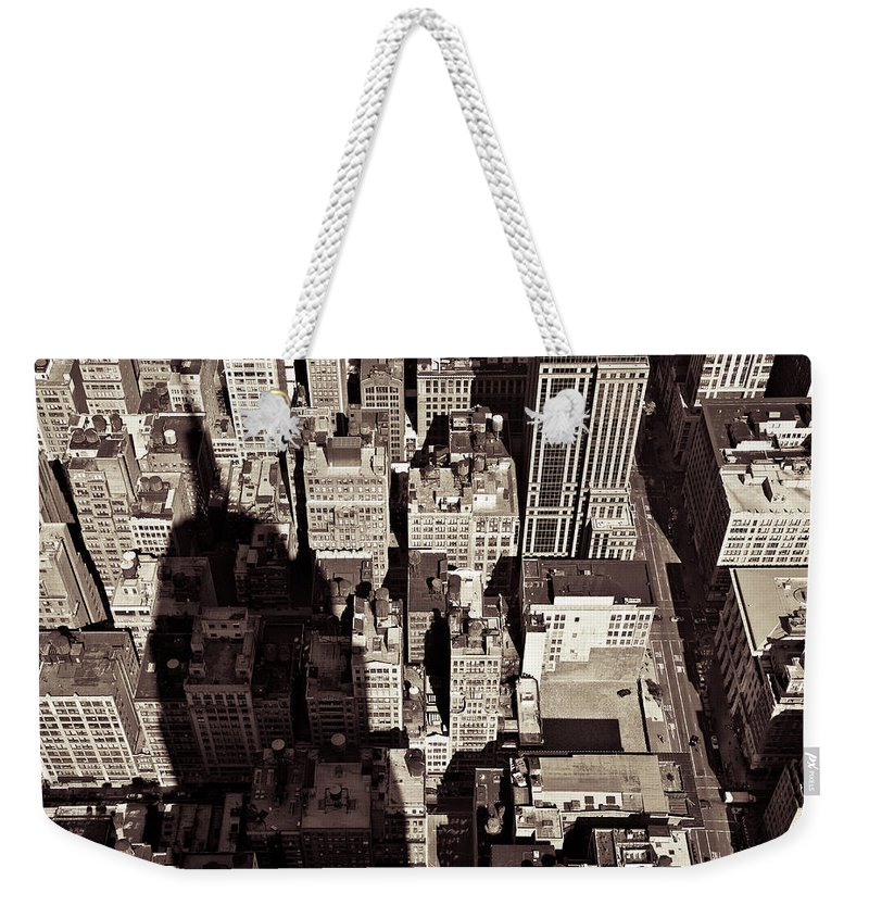 New York Weekender Tote Bag featuring the photograph City Shadow by Dave Bowman
