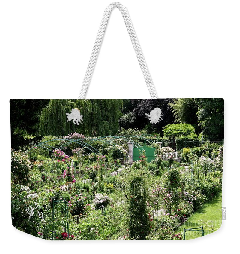 Claude Monet Weekender Tote Bag featuring the photograph Claude Mounets Green Garden Gate by Christiane Schulze Art And Photography
