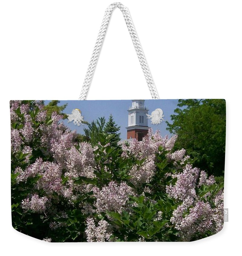 Lilac Weekender Tote Bag featuring the photograph Clock Tower And Lilacs by Laurie Eve Loftin