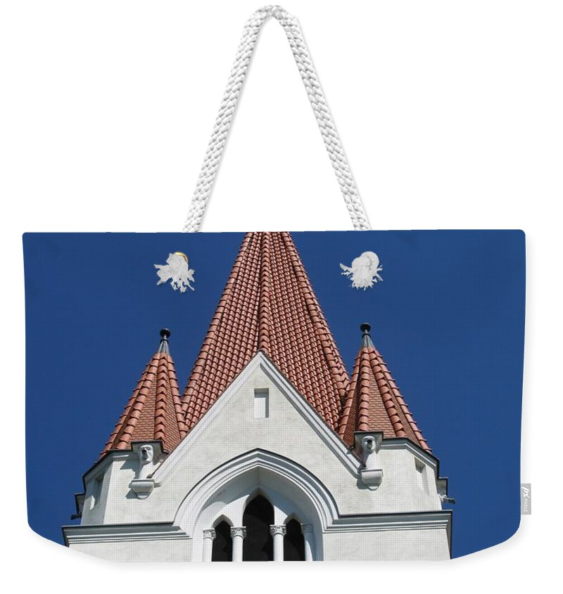 Clock Weekender Tote Bag featuring the photograph Clock Tower. Evangelic Lutheran Church. Silute. Lithuania. by Ausra Huntington nee Paulauskaite