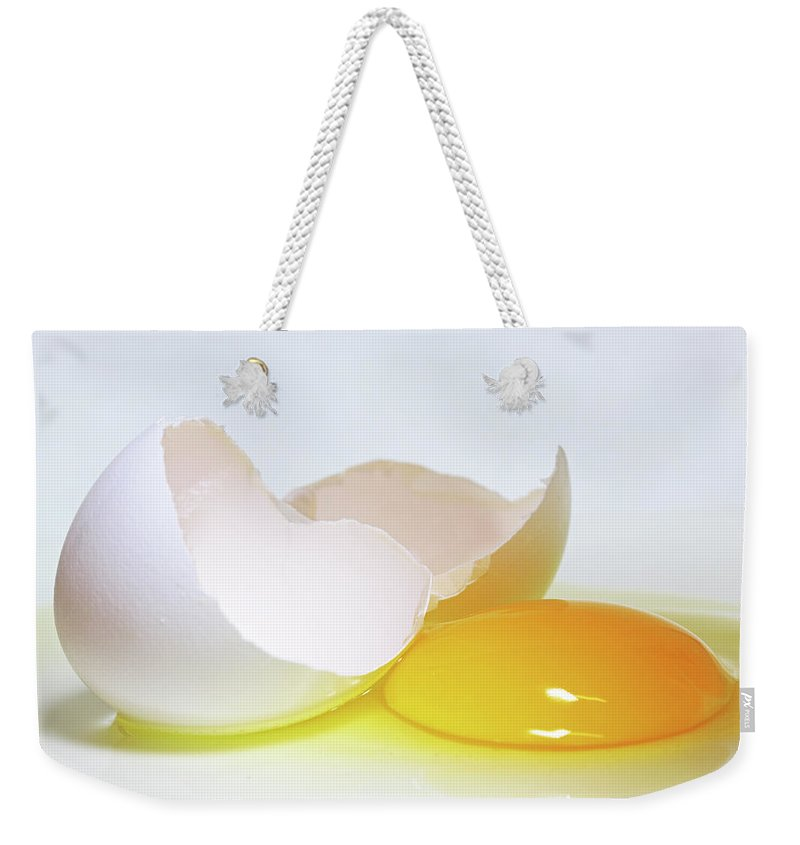 White Background Weekender Tote Bag featuring the photograph Close-up Of A Broken Egg On White by Zen Rial
