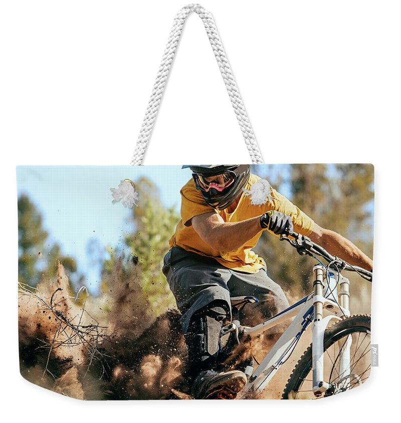 Headwear Weekender Tote Bag featuring the photograph Close Up Of A Mountain Biker Ripping by Daniel Milchev