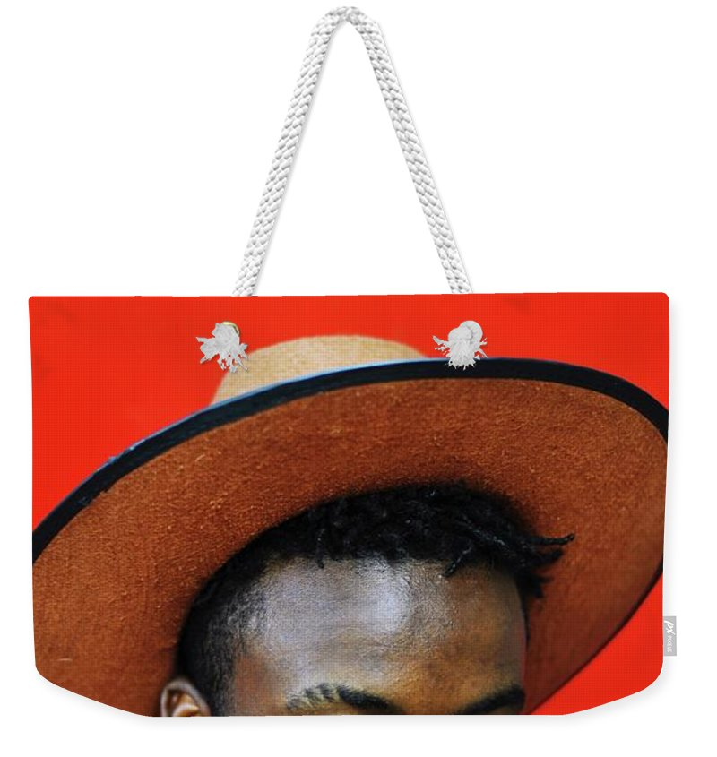 Young Men Weekender Tote Bag featuring the photograph Close-up Of Man Wearing Hat Against Red by Samson Wamalwa / Eyeem